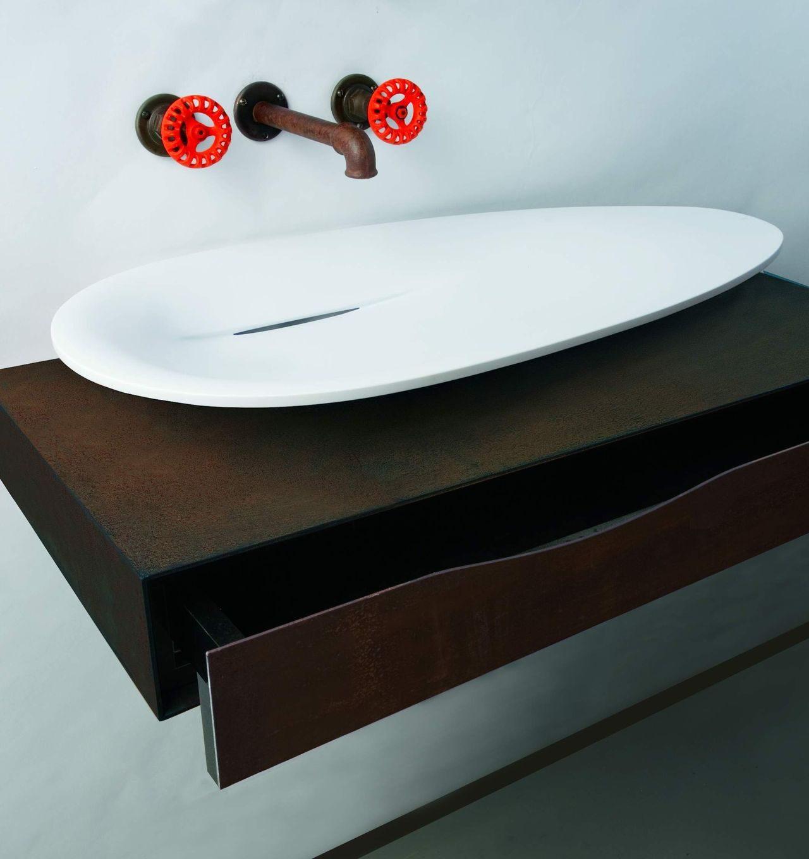 First washbasin on cabinet